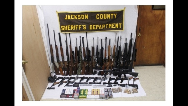 Large Cache of Guns, Ammo Seized in Newport